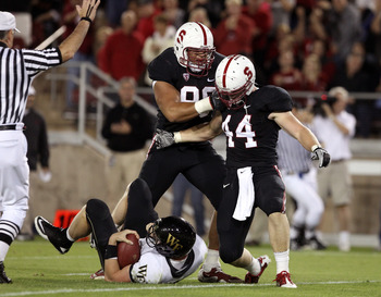 PALO ALTO, CA - SEPTEMBER 18:  Matthew Masifilo #98 and Chase Thomas #44 of the Stanford Cardinal celebrate after Thomas sacked Price Tanner #11 of the Wake Forest Demon Deacons at Stanford Stadium on September 18, 2010 in Palo Alto, California.  (Photo b