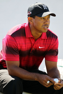 LEMONT, IL - SEPTEMBER 12:  Tiger Woods sits at the 12th tee during the final round of the BMW Championship at Cog Hill Golf & Country Club on September 12, 2010 in Lemont, Illinois.  (Photo by Jamie Squire/Getty Images)
