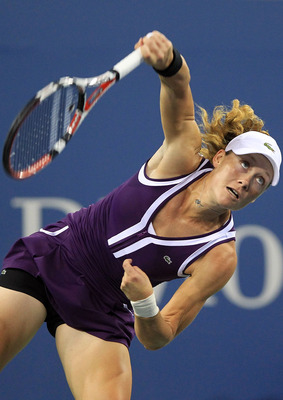 NEW YORK - SEPTEMBER 07:  Samantha Stosur of Australia serves against Kim Clijsters of Belgium during day nine of the 2010 U.S. Open at the USTA Billie Jean King National Tennis Center on September 7, 2010 in the Flushing neighborhood of the Queens boroug