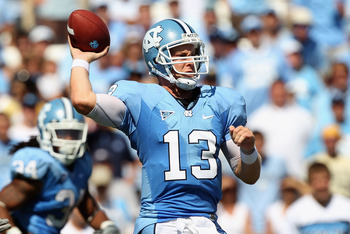 CHAPEL HILL, NC - SEPTEMBER 18: T.J. Yates #13 of the North Carolina Tar Heels drops back to throw a pass against the Georgia Tech Yellow Jackets during their game at Kenan Stadium on September 18, 2010 in Chapel Hill, North Carolina.  (Photo by Streeter