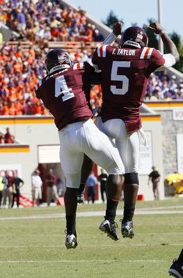 BLACKSBURG, VA - SEPTEMBER 18:  Running back David Wilson #4 and quarterback Tyrod Taylor #5 of the Virgina Tech Hokies celebrate after Wilson scored a touchdown against the East Carolina Pirates at Lane Stadium on September 18, 2010 in Blacksburg, Virgin