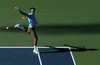 NEW YORK - SEPTEMBER 11:  Roger Federer of Switzerland returns a shot against Novak Djokovic of Serbia during his men's singles semifinal match on day thirteen of the 2010 U.S. Open at the USTA Billie Jean King National Tennis Center on September 11, 2010