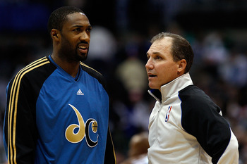 DALLAS - OCTOBER 27:  Guard Gilbert Arenas #0 of the Washington Wizards talks with NBA referee Ron Garretson #10 during the season opener on October 27, 2009 at American Airlines Center in Dallas, Texas.  NOTE TO USER: User expressly acknowledges and agre