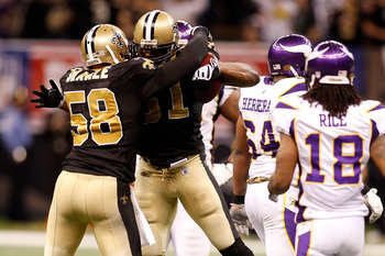 NEW ORLEANS - JANUARY 24:  Jonathan Vilma #51 and Scott Shanle #58 of the New Orleans Saints celebrate a defensive stop in the second quarter against the Minnesota Vikings during the NFC Championship Game at the Louisiana Superdome on January 24, 2010 in