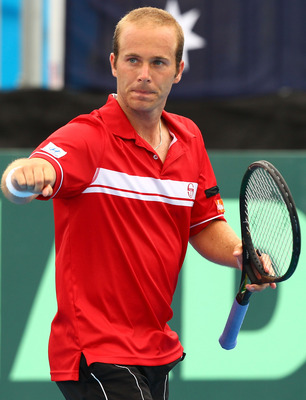 CAIRNS, AUSTRALIA - SEPTEMBER 20:  Olivier Rochus of Belgium celebrates a point in his match against Peter Luczak of Australia during day four of the Davis Cup tie between Australia and Belgium at Cairns International Tennis Centre on September 20, 2010 i