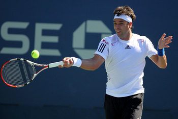 NEW YORK - AUGUST 30:  Fernando Gonzalez of Chile returns a forehand against Ivan Dodig of Croatia in the Men's Singles first round match on day one of the 2010 U.S. Open at the USTA Billie Jean King National Tennis Center on August 30, 2010 in the Flushi