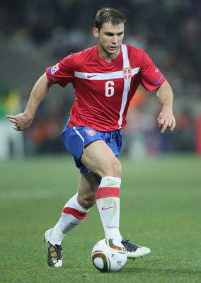 NELSPRUIT, SOUTH AFRICA - JUNE 23: Branislav Ivanovic of Serbia runs with the ball during the 2010 FIFA World Cup South Africa Group D match between Australia and Serbia at Mbombela Stadium on June 23, 2010 in Nelspruit, South Africa.  (Photo by Christof