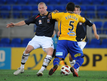 GOLD COAST, AUSTRALIA - SEPTEMBER 22:  Kasey Wehrman of the Jets contests the ball with Robson of the Gold Coast during the round seven A-League match between Gold Coast United and the Newcastle Jets at Skilled Park on September 22, 2010 in Gold Coast, Au