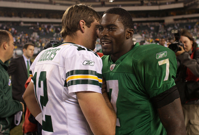 PHILADELPHIA - SEPTEMBER 12:  Michael Vick #7 of the Philadelphia Eagles walks off the field and greets Aaron Rodgers #12 of the Green Bay Packers after a loss at Lincoln Financial Field on September 12, 2010 in Philadelphia, Pennsylvania. The Packers bea