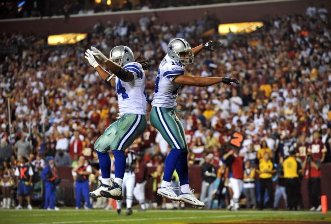 LANDOVER - SEPTEMBER 12:  Miles Austin #19 of the Dallas Cowboys celebrates his touchdown during the NFL season opener against the Washington Redskins at FedExField on September 12, 2010 in Landover, Maryland. The Redskins defeated the Cowboys 13-7. (Phot