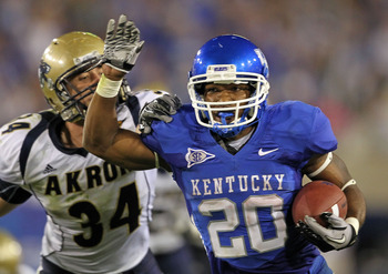 LEXINGTON, KY - SEPTEMBER 18:  Derrick Locke #20 of the Kentucky Wildcats runs for a touchdown while defended by Brian Wagner #34 of the Akron Zips during the game  at Commonwealth Stadium on September 18, 2010 in Lexington, Kentucky.  (Photo by Andy Lyon