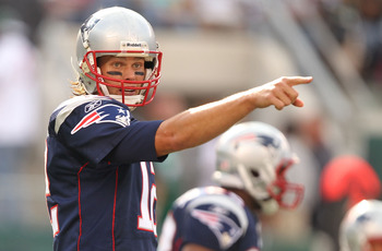 EAST RUTHERFORD, NJ - SEPTEMBER 19:  Tom Brady #12 of the New England Patriots in action against the New York Jets during their  game on September 19, 2010 at the New Meadowlands Stadium  in East Rutherford, New Jersey.  (Photo by Al Bello/Getty Images)
