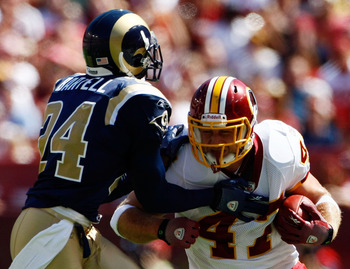 LANDOVER, MD - SEPTEMBER 20:  Chris Cooley #47 of the Washington Redskins carries the ball upfield as Ron Bartell #24 of the St. Louis Rams makes the tackle during their game on September 20, 2009 at FedEx Field in Landover, Maryland.  (Photo by Win McNam