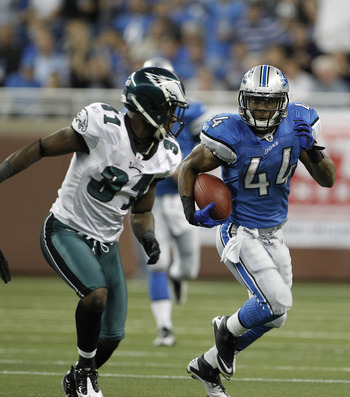DETROIT - SEPTEMBER 19: Jahvid Best #44 of the Detroit Lions runs for a first down during the game against the Philadelphia Eagles as Ellis Hobbs #31 attempts to make the stop during the game against the Detroit Lions at Ford Field on September 19, 2010 i