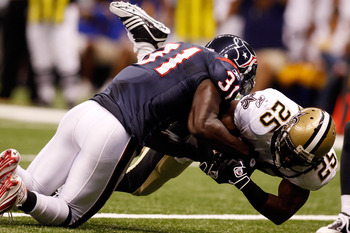 NEW ORLEANS - AUGUST 21:  Reggie Bush #25 of the New Orleans Saints is tackled as he scores a touchdown by Bernard Pollard #31 of the Houston Texans at the Louisiana Superdome on August 21, 2010 in New Orleans, Louisiana.  (Photo by Chris Graythen/Getty I