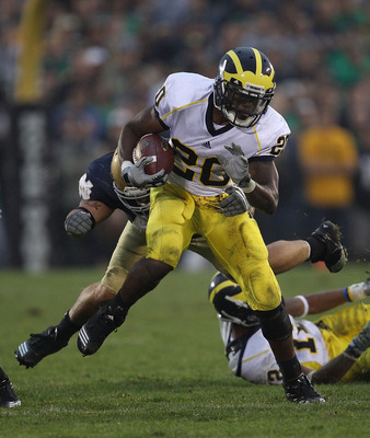 SOUTH BEND, IN - SEPTEMBER 11: Michael Shaw #20 of the Michigan Wolverines runs for yardage against the Notre Dame Fighting Irish at Notre Dame Stadium on September 11, 2010 in South Bend, Indiana. Michigan defeated Notre Dame 28-24. (Photo by Jonathan Da