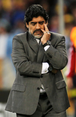 CAPE TOWN, SOUTH AFRICA - JULY 03:  Diego Maradona head coach of Argentina shows his dejection as he suffers a massive defeat in the 2010 FIFA World Cup South Africa Quarter Final match between Argentina and Germany at Green Point Stadium on July 3, 2010