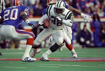 19 Dec 1998:  Running back Curtis Martin #29 of the New York Jets in action against safety Henry Jones #20 of the Buffalo Bills during the game at Ralph Wilson Stadium in Buffalo, New York. The Jets defeated the Bills 17-10. Mandatory Credit: Rick Stewart