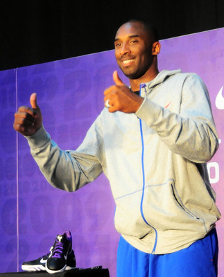 GUANGZHOU, CHINA - JULY 29:  (CHINA OUT) NBA player Kobe Bryant of the Los Angeles Lakers gestures during a meet and greet with fans at Jinan University on July 29, 2010 in Guangzhou, Guangdong Province of China.  (Photo by ChinaFotoPress/Getty Images)
