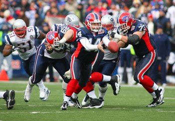 ORCHARD PARK, NY - DECEMBER 20: Ryan Fitzpatrick #14 of the Buffalo Bills looks to hand off the ball against the New England Patriots during the game at Ralph Wilson Stadium on December 20, 2009 in Orchard Park, New York. (Photo by: Rick Stewart/Getty Ima