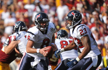 LANDOVER, MD - SEPTEMBER 19:  Matt Schaub #8 of the Houston Texans hands off to Arian Foster #23 of the Houston Texans during the game against the Washington Redskins at FedExField on September 19, 2010 in Landover, Maryland. The Texans defeated the Redsk