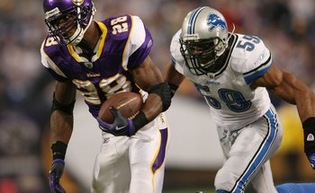 MINNEAPOLIS - NOVEMBER 15:  Adrian Peterson #28 of the Minnesota Vikings carries the ball as Julian Peterson #59 of the Detroit Lions defends on November 15, 2009 at Hubert H. Humphrey Metrodome.  (Photo by Elsa/Getty Images)