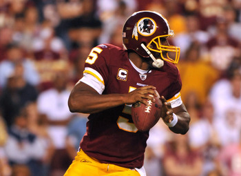 LANDOVER, MD - SEPTEMBER 19:  Donovan McNabb #5 of the Washington Redskins looks for a receiver during the game against the Houston Texans at FedExField on September 19, 2010 in Landover, Maryland. The Texans defeated the Redskins in overtime 30-27. (Phot