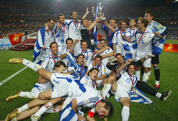 LISBON, PORTUGAL - JULY 4:  Greece celebrate with the trophy after winning the UEFA Euro 2004, Final match between Portugal and Greece at the Luz Stadium on July 4, 2004 in Lisbon, Portugal. (Photo by Ben Radford/Getty Images)