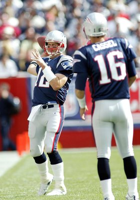FOXBORO, MA - SEPTEMBER 10:  Tom Brady #12 of the New England Patriots keeps loose by throwing passes to Matt Cassel #16 during a timeout against the Buffalo Bills on September 10, 2006 at Gillette Stadium in Foxboro, Massachusetts. The Patriots defeated
