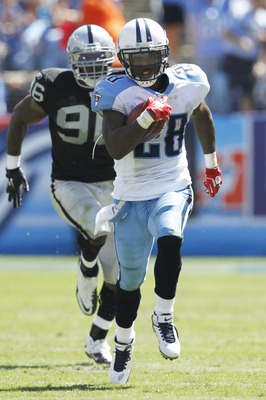 NASHVILLE - SEPTEMBER 12: Chris Johnson #28 of the Tennessee Titans outruns Kamerion Wimbley #96 of the Oakland Raiders for a 76-yard touchdown in the first half of the NFL season opener at LP Field on September 12, 2010 in Nashville, Tennessee. (Photo by