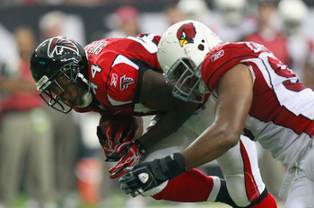 ATLANTA - SEPTEMBER 19:  Jason Snelling #44 of the Atlanta Falcons is tackled by Calais Campbell #93 of the Arizona Cardinals at Georgia Dome on September 19, 2010 in Atlanta, Georgia.  (Photo by Kevin C. Cox/Getty Images)