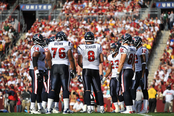 LANDOVER - SEPTEMBER 19:  Matt Schaub #8 of the Houston Texans leads the huddle during the game against the Washington Redskins at FedExField on September 19, 2010 in Landover, Maryland. The Texans defeated the Redskins in overtime 30-27. (Photo by Larry