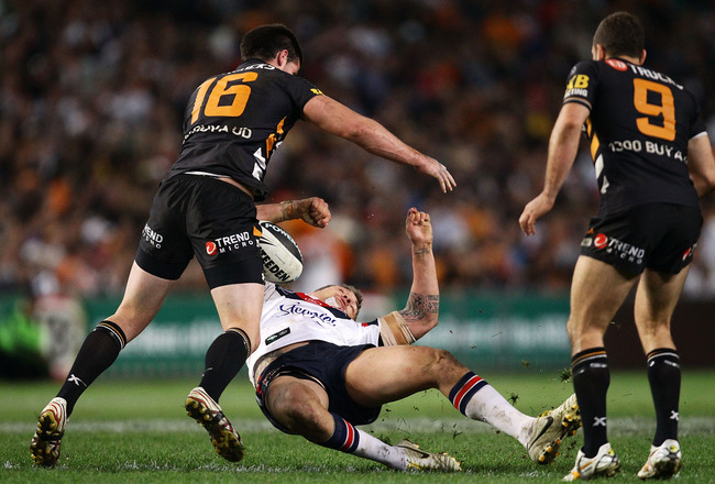 SYDNEY, AUSTRALIA - SEPTEMBER 11:  Jared Waerea-Hargraves of the Roosters is hit hard in a tackle by Simon Dwyer of the Tigers in the last minute of regular time during the NRL Second Qualifying Final match between the Wests Tigers and the Sydney Roosters