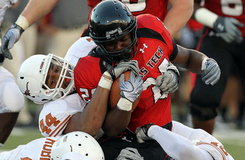 LUBBOCK, TX - SEPTEMBER 18:  Running back Eric Stephens #24 of the Texas Tech Red Raiders is tackled by Jackson Jeffcoat #44 of the Texas Longhorns at Jones AT&amp;T Stadium on September 18, 2010 in Lubbock, Texas.  (Photo by Ronald Martinez/Getty Images)