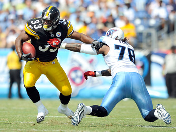 NASHVILLE, TN - SEPTEMBER 19:  Isaac Redman #33 of the Pittsburgh Steelers breaks away from Jacob Ford #78 of the Tennessee Titans  during the first half at LP Field on September 19, 2010 in Nashville, Tennessee.  (Photo by Grant Halverson/Getty Images)
