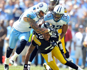 NASHVILLE, TN - SEPTEMBER 19:  Jason Babin #93 and Michael Griffin #33 of the Tennessee Titans pressure quarterback Dennis Dixon #10 of the Pittsburgh Steelers during the first half at LP Field on September 19, 2010 in Nashville, Tennessee.  (Photo by Gra