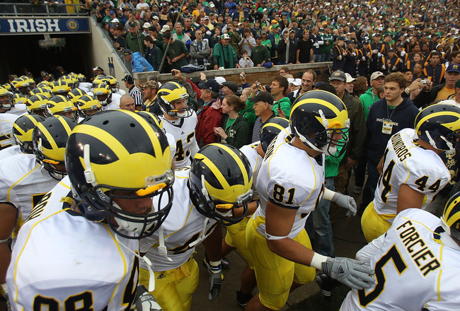 SOUTH BEND, IN - SEPTEMBER 11: Members of the Michigan Wolverines run onto the field before a game against the Notre Dame Fighting Irish at Notre Dame Stadium on September 11, 2010 in South Bend, Indiana. Michigan defeated Notre Dame 28-24. (Photo by Jona