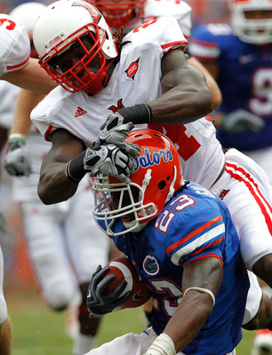 GAINESVILLE, FL - SEPTEMBER 04:  Mike Gillislee #23 of the Florida Gators is tackled by Allen Veazie #2 of the Miami University RedHawks at Ben Hill Griffin Stadium on September 4, 2010 in Gainesville, Florida.  (Photo by Sam Greenwood/Getty Images)