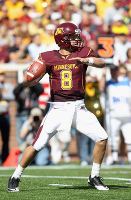 MINNEAPOLIS - SEPTEMBER 18:  Quarterback Adam Weber #8 of the Minnesota Golden Gophers passes during the game against the USC Trojans on September 18, 2010 at TCF Bank Stadium in Minneapolis, Minnesota.  (Photo by Jamie Squire/Getty Images)