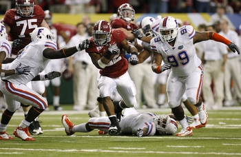 ATLANTA - DECEMBER 5:  Mark Ingram #22 of the Alabama Crimson Tide runs the ball against Omar Hunter #99 of the Florida Gators during the SEC Championship game at Georgia Dome on December 5, 2009 in Atlanta, Georgia. Alabama won 32-13. (Photo by Chris Gra
