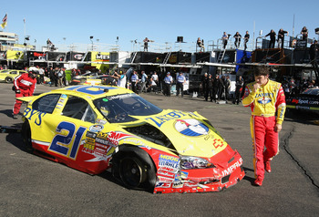 PHOENIX - APRIL 09:  John Wes Townley, driver of the #21 Zaxby's Chevrolet, looks at his car after a crash during practice for the NASCAR Nationwide Series Bashas' Supermarkets 200 at Phoenix International Raceway on April 9, 2010 in Phoenix, Arizona.  (P