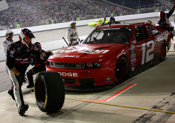 RICHMOND, VA - SEPTEMBER 10:  Justin Allgaier, driver of the #12 Verizon Wireless Dodge, pits during the NASCAR Nationwide Series Virginia 529 College Savings 250 at Richmond International Raceway on September 10, 2010 in Richmond, Virginia.  (Photo by Ch