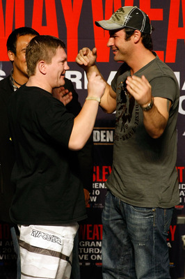 Hatton (left) with Calzaghe at the Mosley-Mayweather press conference