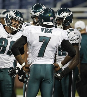 DETROIT - SEPTEMBER 19:  Michael Vick #7 of the Philadelphia Eagles calls the play in the huddle during warms up prior to the start of the game against the Detroit Lions at Ford Field on September 19, 2010 in Detroit, Michigan.  (Photo by Leon Halip/Getty