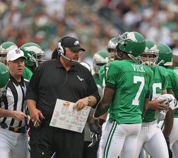PHILADELPHIA - SEPTEMBER 12:  Michael Vick #7 of the Philadelphia Eagles talks with head coach Andy Reid during a game against the Green Bay Packers at Lincoln Financial Field on September 12, 2010 in Philadelphia, Pennsylvania.  (Photo by Mike Ehrmann/Ge