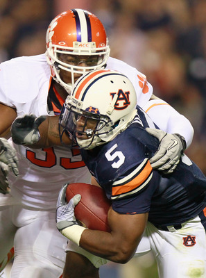 AUBURN, AL - SEPTEMBER 18:  Michael Dyer #5 of the Auburn Tigers is tackled by Da'Quan Bowers #93 of the Clemson Tigers at Jordan-Hare Stadium on September 18, 2010 in Auburn, Alabama.  (Photo by Kevin C. Cox/Getty Images)