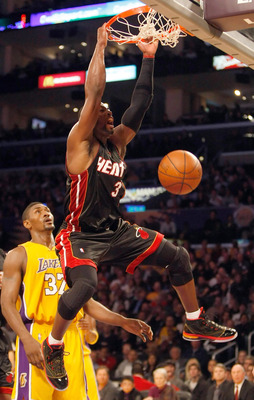 LOS ANGELES, CA - DECEMBER 04:  Dwyane Wade #3 of the Miami Heat dunks the ball in front of Ron Artest #37 of the Los Angeles Lakers in the first half at Staples Center on December 4, 2009 in Los Angeles, California. NOTE TO USER: User expressly acknowled