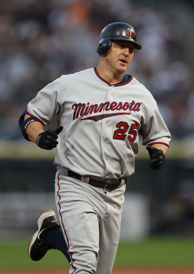 CHICAGO - AUGUST 10: Jim Thome #25 of the Minnesota Twins runs the bases after his 1st inning home run against the Chicago White Sox at U.S. Cellular Field on August 10, 2010 in Chicago, Illinois. The Twins defeated the White Sox 12-6. (Photo by Jonathan