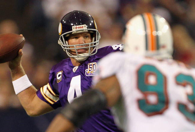 MINNEAPOLIS - SEPTEMBER 19:  Quarterback Brett Favre #4 of the Minnesota Vikings drops back to pass as Quentin Moses #93 of the Miami Dolphins defends during the game on September 19, 2010 at Hubert H. Humphrey Metrodome in Minneapolis, Minnesota.  (Photo