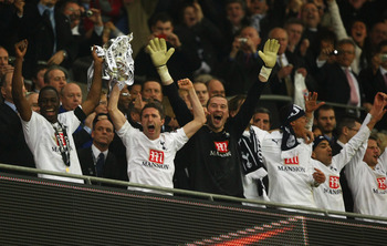 LONDON - FEBRUARY 24:  Captain Ledley King of Tottenham Hotspur (L) lifts the trophy with Robbie Keane following victory during the Carling Cup Final between Tottenham Hotspur and Chelsea at Wembley Stadium on February 24, 2008 in London, England. Tottenh